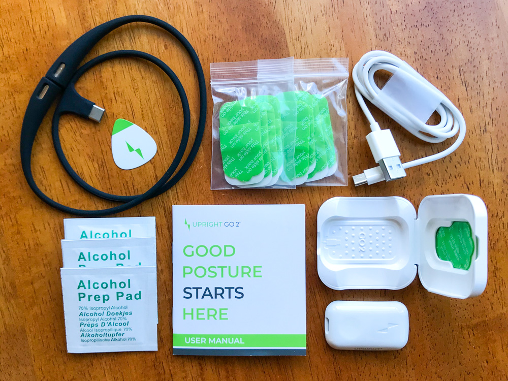 upright go 2 review posture trainer with necklace, charger, and adhesives